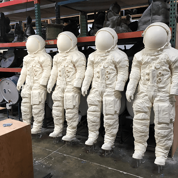 Resin cast full size replicas of space suit worn by Neil Armstrong for the moon landing July 20, 1969
